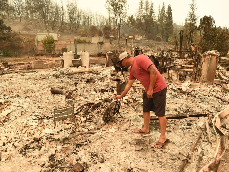 Wade Brilz looks at what remains of his burned home during the Carr fire in Redding