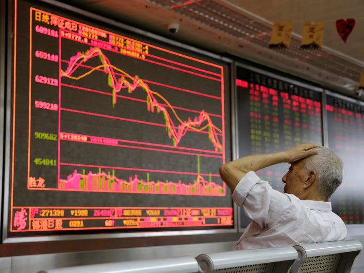 An investor reacts to stock market information in Beijing as the US tariffs come into effect