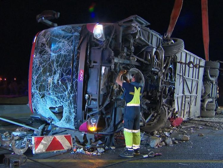 The underside of the coach being examined after the crash
