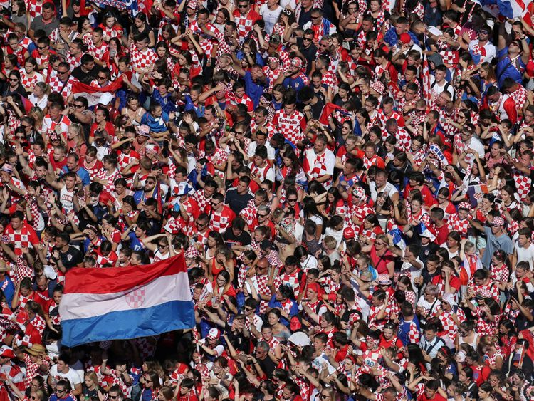 Joyful crowds await to greet the Croatia football team in the country's capital