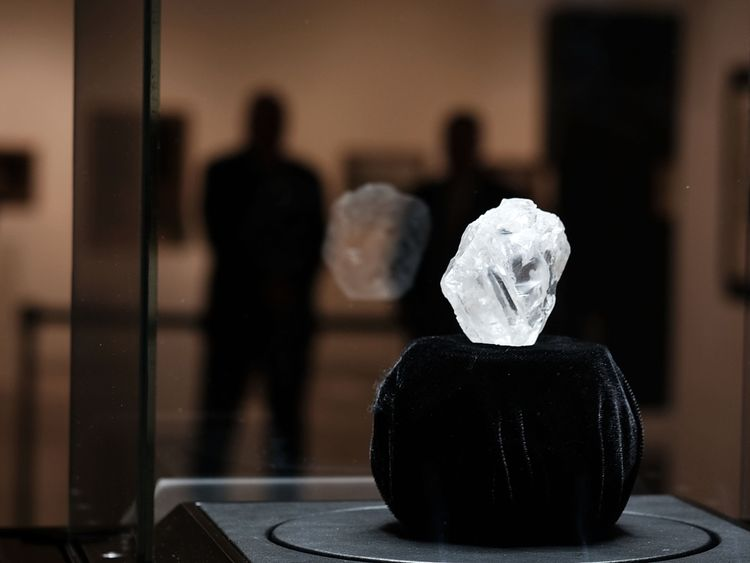 NEW YORK, NY - MAY 04: Guards stand next to the 1109-carat rough Lesedi La Rona diamond, the biggest rough diamond discovered in more than a century, at Sotheby's on May 04, 2016 in New York City. The stone was found by Lucara Diamond Corp. last year at its Karowe mine in Botswana. The diamond, which is nearly the size of a tennis ball at 66.4 x 55 x 42 mm and is believed to be about 2.5 billion to 3 billion years old, was named 'Our Light' in the local Tswana language. Lesedi La Rona will be of