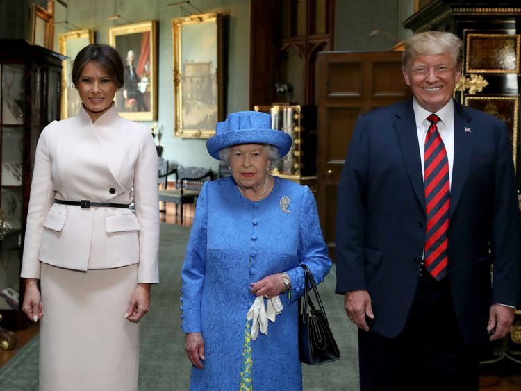 Queen Elizabeth II stands with US President Donald Trump and his wife, Melania, during their visit to Windsor Castle