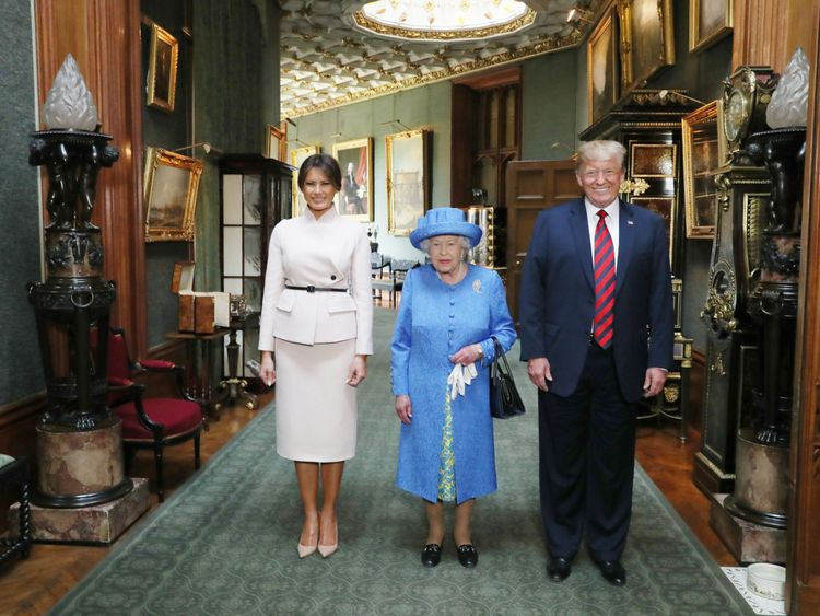 Queen Elizabeth stands with Donald Trump and his wife, Melania, in the Grand Corridor during their visit to Windsor Castle