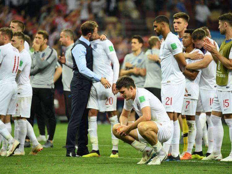 England's Harry Maguire (front) reacts along with teammates at the end of the 2018 World Cup semi-final football match between Croatia and England