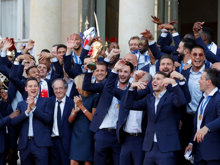 President Macron and his wife Brigitte Macron pose with the team at the Elysee Palace