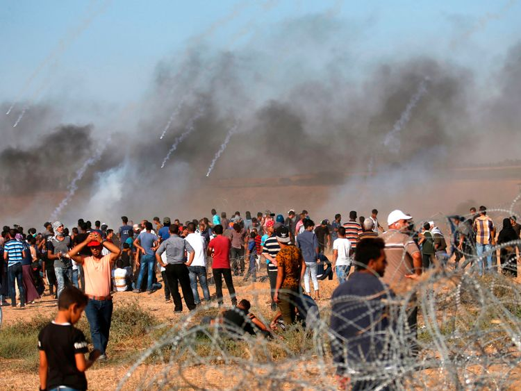 A picture taken on July 20, 2018 shows tear gas canisters fired by Israeli forces landing amidst protesters along the border with Israel east of Khan Yunis in the southern Gaza Strip