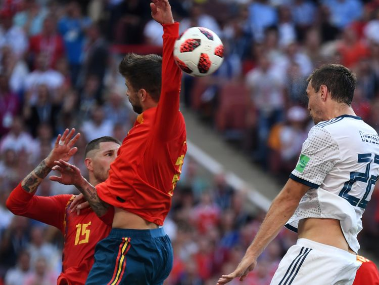 Spain's Gerard Pique handles the ball in the box to concede a penalty