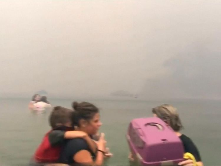 Hundreds fled into the water to try to survive the fire