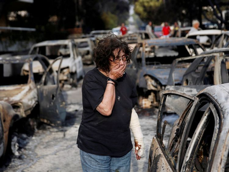 A woman reacts as she tries to find her dog, following a wildfire at the village of Mati, near Athens, Greece July 24, 2018. REUTERS/Costas Baltas TPX IMAGES OF THE DAY