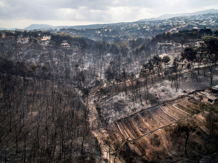 An aerial view shows damage caused by a wildfire near the village of Mati near Athens