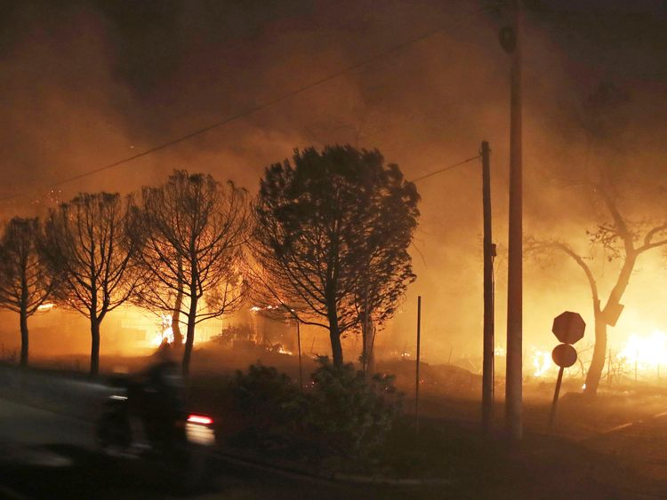 Buildings burn in the town of Mati, east of Athens