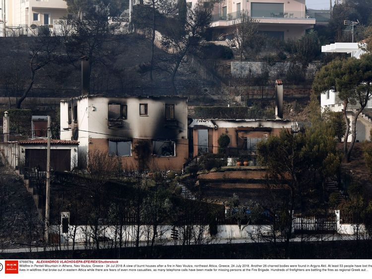 Burnt houses after a fire in Neo Voutza, northeast Attica