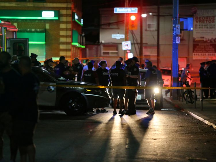 Police are seen near the scene of a mass shooting in Toronto Canada