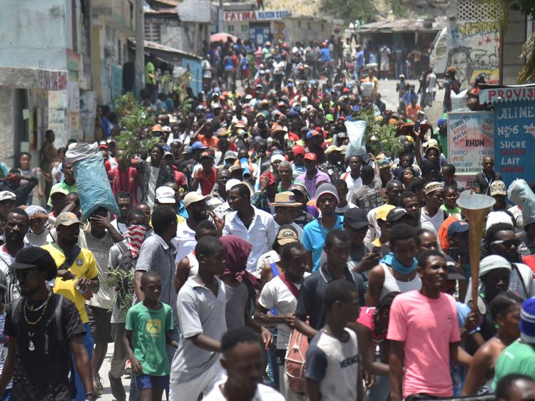 Demonstrators marched through the streets of Port-au-Prince against the government