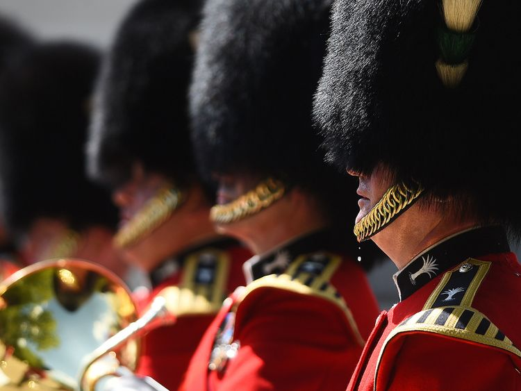 A member of the Queen's Guard feels the heat in his uniform
