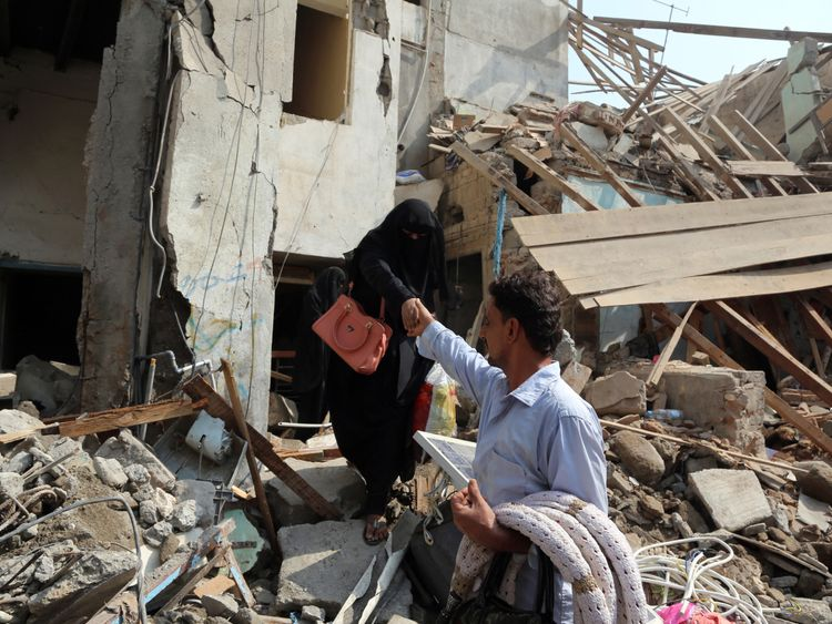 Yemenis make their way through the rubble of buildings destroyed during Saudi-led air strikes the previous day, on September 22, 2016 in the port city of Hodeida