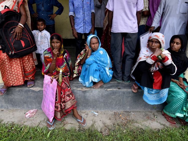 Villagers wait outside the National Register of Citizens centre to get their documents verified