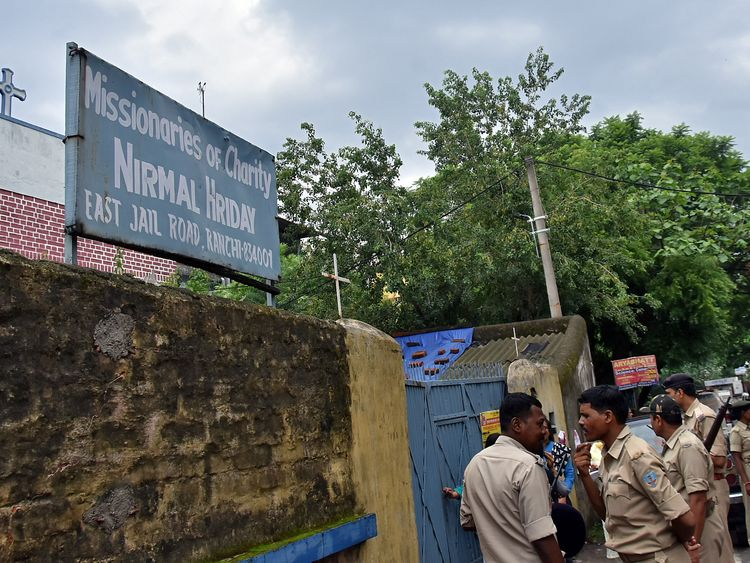 Police stand outside a home run by the Missionaries of Charity in Ranchi, India