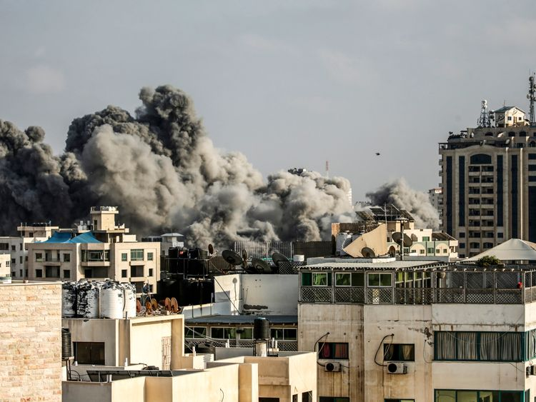 A picture taken on July 14, 2018 shows smoke plumes risisng following an Israeli air strike in Gaza City. - Israel's military said it had launched air strikes targeting Hamas in the Gaza Strip on July 14 as rockets and mortars were lobbed into southern Israel from the blockaded Palestinian enclave. (Photo by MAHMUD HAMS / AFP) (Photo credit should read MAHMUD HAMS/AFP/Getty Images)