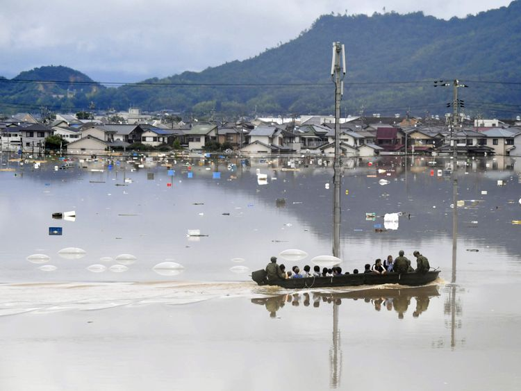 Japan's 'race against time' to save flood victims after ...