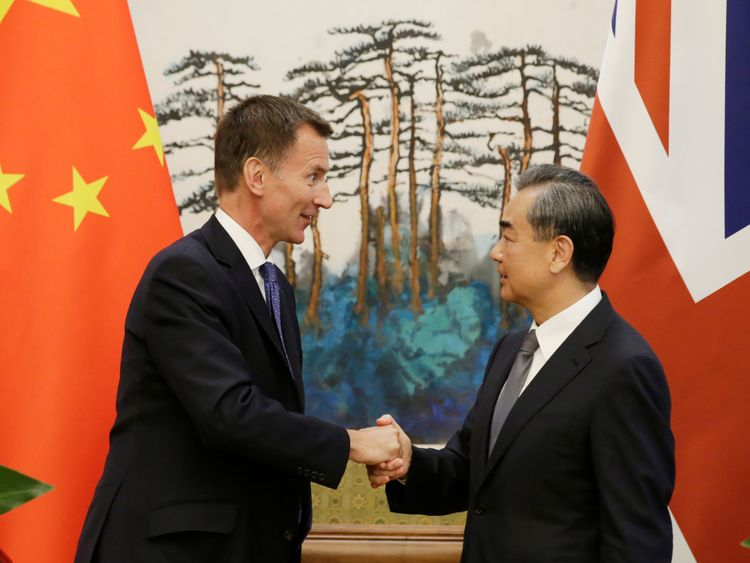 Jeremy Hunt with China's foreign minister Wang Yi
