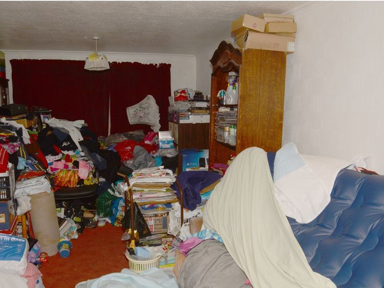 "The living room of Jordan Burling's family home in Farnley, Leeds where he was found after being left to ""rot to death"" on an inflatable mattress"