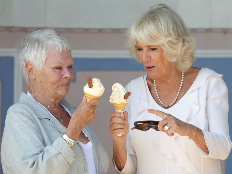 The Duchess of Cornwall enjoys an ice cream with Dame Judi Dench as she arrives at Queen Victoria's private beach