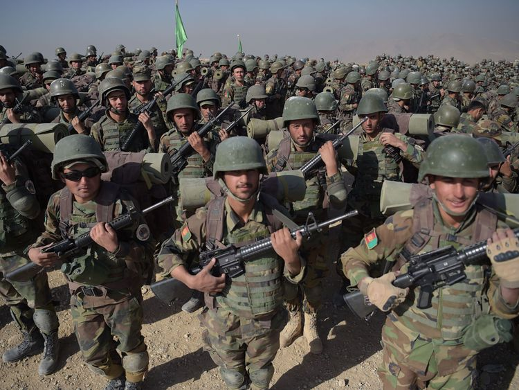 Afghan National Army (ANA) soldiers march during a military exercise at the Kabul Military Training Centre (KMTC) on the outskirts of Kabul on October 17, 2017