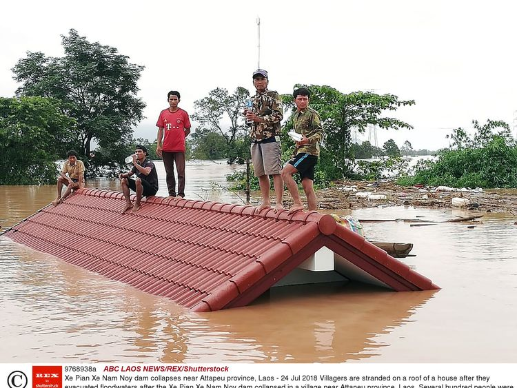 Villagers are stranded on a roof of a house after they evacuated floodwaters after the Xe Pian Xe Nam Noy dam collapsed