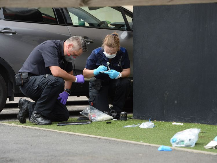 Crime scene investigators at the scene