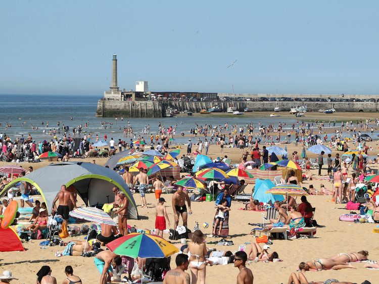 People enjoy the beach in Margate, Kent