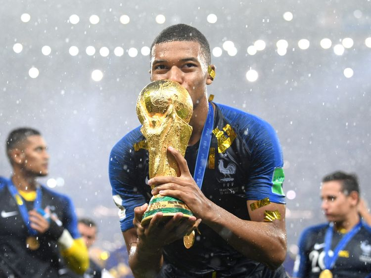 Kylian Mbappe of France celebrates with the World Cup trophy
