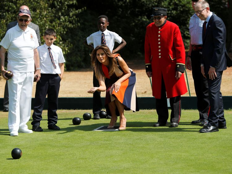 First Lady Melania Trump and Philip May, the husband of Britain's Prime Minister Theresa May, take part in a game of bowls with veterans and schoolchildren during a visit to the Royal Hospital Chelsea in London, Britain