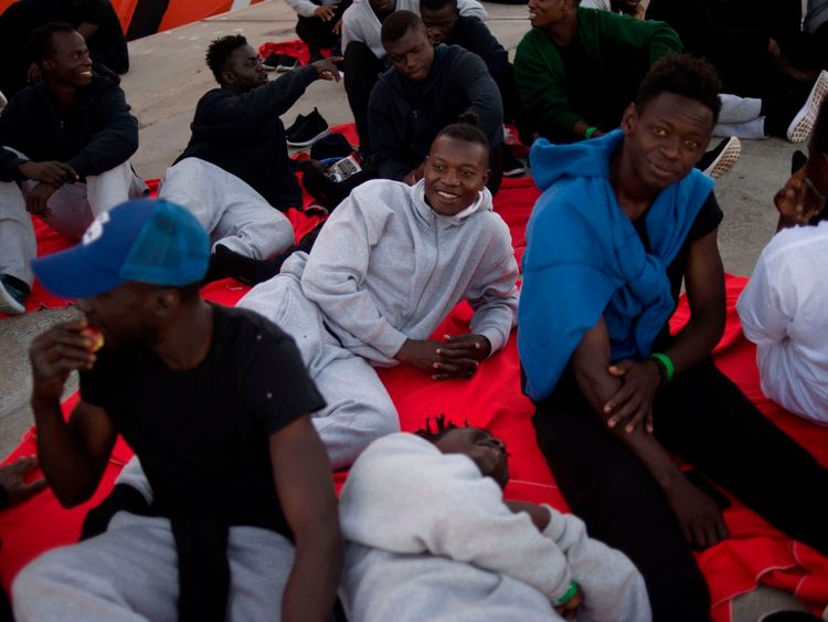 Migrants rescued at sea wait to be transferred at the harbour of Algeciras