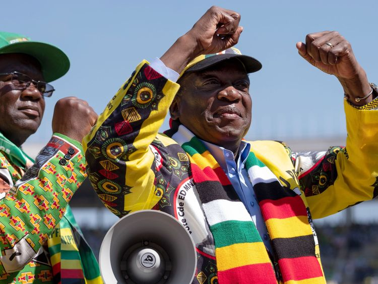 Zimbabwe's incumbent President and candidate Emmerson Mnangagwa arrives for his closing presidential campaign rally in Harare, on July 28, 2018, two days ahead of the elections