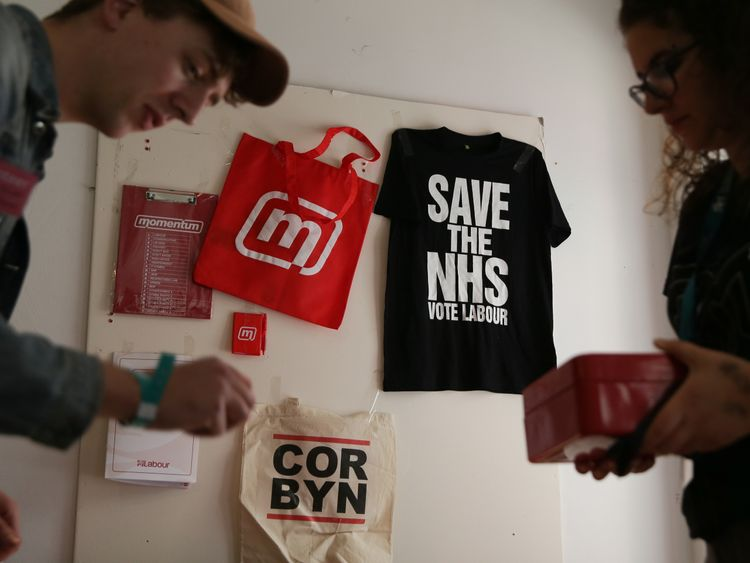 Momentum volunteers arrange souvenirs at The World Transformed event on the sidelines of the Labour party conference in Brighton on September 23, 2017. Britain's revitalised Labour opposition kicks off its annual conference on Sunday with leader Jeremy Corbyn set to lay out his party's agenda, free from the leadership challenges of previous years. / AFP PHOTO / Daniel LEAL-OLIVAS (Photo credit should read DANIEL LEAL-OLIVAS/AFP/Getty Images)