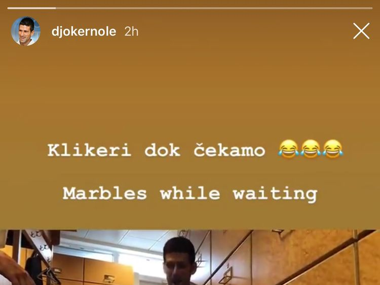 Novak Djokovic resorted to playing marbles as he waited. Pic: Instagram/Djokernole