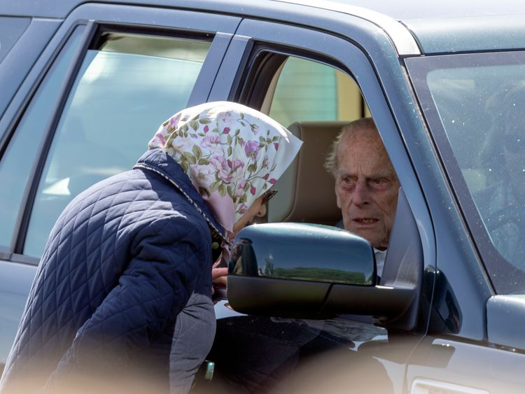 Queen Elizabeth II talking to the Duke of Edinburgh during the Royal Windsor Horse Show at Windsor Castle in May 2018