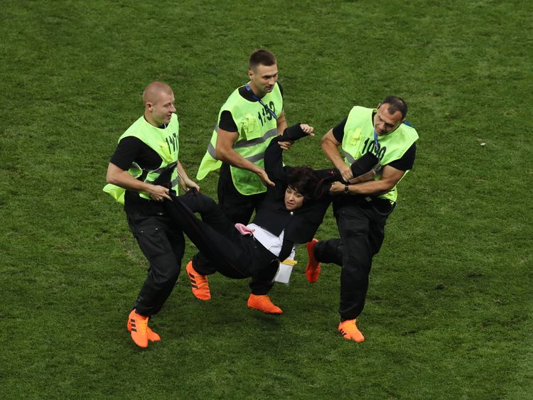 MOSCOW, RUSSIA - JULY 15: Stewards drag a pitch invader off the pitch during the 2018 FIFA World Cup Final between France and Croatia at Luzhniki Stadium on July 15, 2018 in Moscow, Russia. (Photo by Kevin C. Cox/Getty Images)