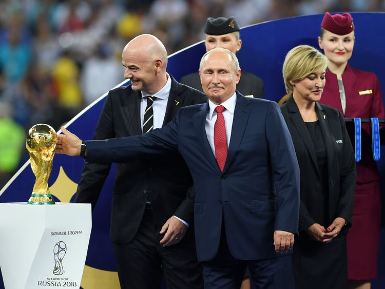 MOSCOW, RUSSIA - JULY 15: President of Russia Valdimir Putin touches the World Cup trophy as FIFA president Gianni Infantino looks on during the 2018 FIFA World Cup Final between France and Croatia at Luzhniki Stadium on July 15, 2018 in Moscow, Russia. (Photo by Shaun Botterill/Getty Images)