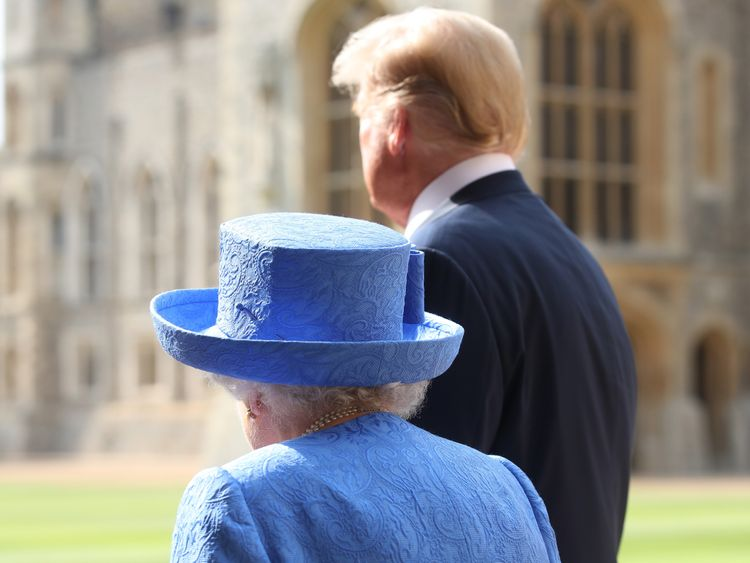 US President Donald Trump and Queen Elizabeth II walk in the Quadrangle at Windsor Castle
