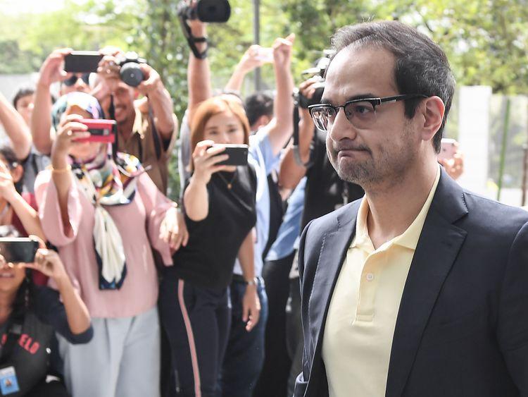 Najib Razak's stepson Riza Aziz arrives to give a statement to police