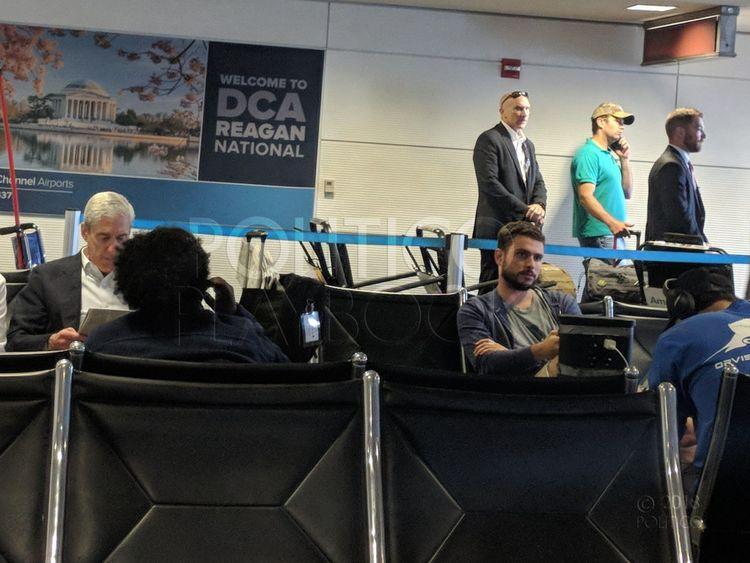 Robert Mueller (on left) and Donald Trump Jr (in baseball cap) at Ronald Reagan Washington National Airport. Pic: Politico Playbook