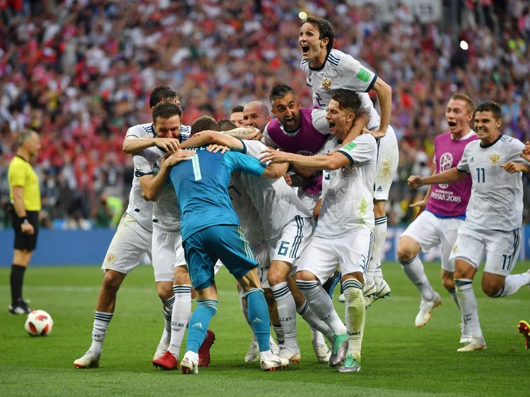 Russian players celebrate their penalties win over Spain in the Luzhniki Stadium, Moscow