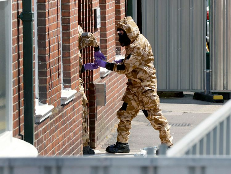 Emergency workers in military protective suits search the fenced off John Baker House for homeless people on Rollestone Street in Salisbury
