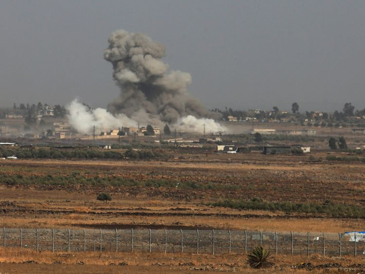 Smoke following an explosions in Syria is seen from the Israeli-occupied Golan Heights near the Israeli Syrian border