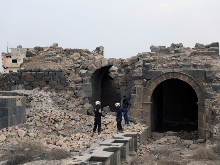 Members of the White Helmets are seen inspecting the damage at a Roman ruin site in Daraa, Syria