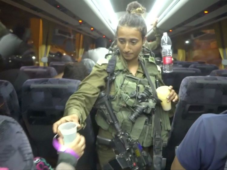 An Israeli solider hands out water on a bus during the Syria Civil Defence also known as the White Helmets extraction from the Golan Heights Israel in this still image taken from video provided by the Israeli Army