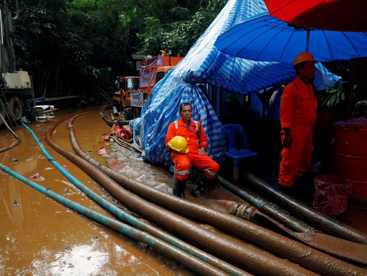 Rescue workers in front of the Tham Luang cave complex
