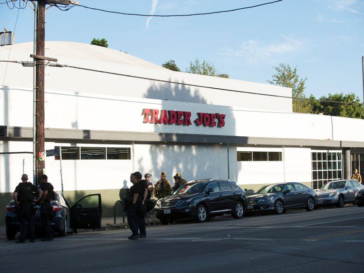 The man ran into a Trader Joe's supermarket